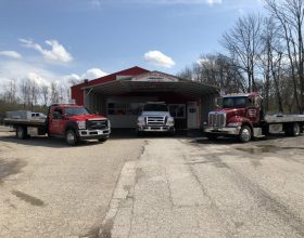 body shop with tow trucks